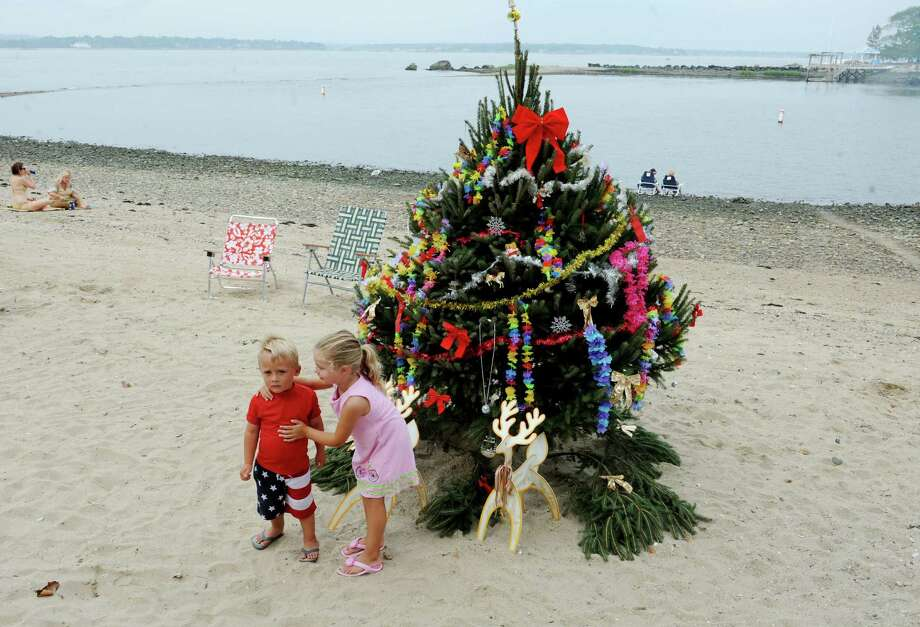 Colton Green, 3, plays with Keeghan Kortner, 4, for Christmas at Island Beach, in Greenwich, Conn., Sunday, Sept.1, 2013. Photo: Helen Neafsey / Greenwich Time