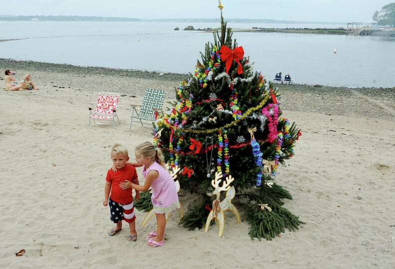 Colton Green, 3, plays with Keeghan Kortner, 4, for Christmas at Island Beach, in Greenwich, Conn.,