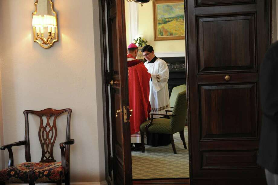 Before the celebration of Mass, Bishop Frank J. Caggiano prepared the help with Rev. Frank Gomez at the Convent of the Sacred Heart, in Greenwich, Conn., Tuesday, Sept. 24, 2013. Photo: Helen Neafsey / Greenwich Time