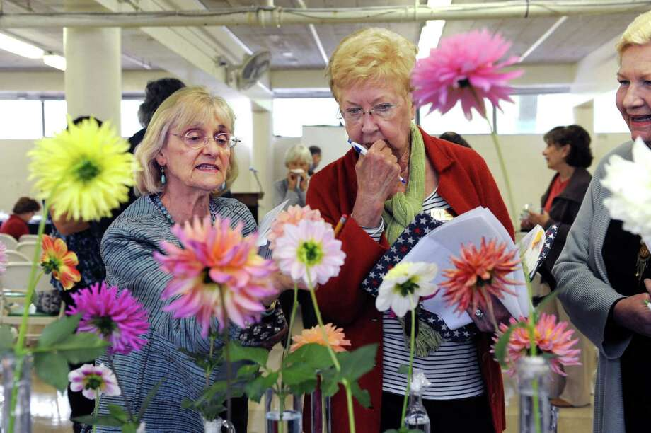 """Carol Steiner, of Wilton, left, June Klopfer, of Stamford, and Anne Harrigan, of Danbury, judges at the """"50 Shades of....Gardening"""", a small standard flower show, at Eastern Greenwich Civic Center, in Old Greenwich, Conn., Wednesday Oct, 9, 2013. The show was presents by Knollwood Garden Club, Riverside Garden Club and the Garden Club of Old Greenwich. Photo: Helen Neafsey / Greenwich Time"""