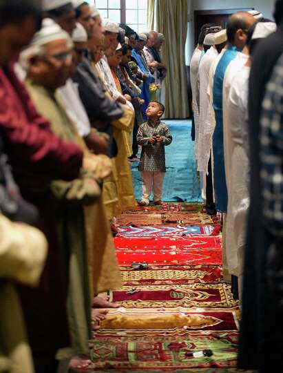 Members of the Stamford Islamic Center participate in Eid al-Fitr prayers to mark the end of Ramadan