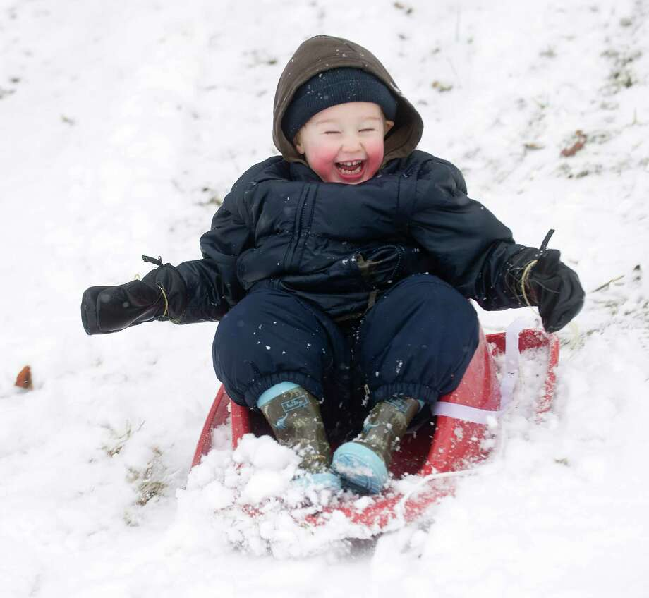 Matthew Foster, 2, sleds at Pemberwick Park in Greenwich, Conn., on Tuesday, December 10, 2013. Photo: Lindsay Perry / Stamford Advocate