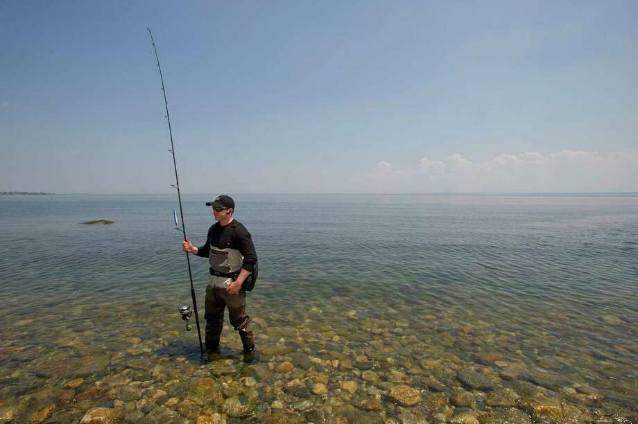 Gregory McNamara fishes in the water of the Long Island Sound at Shippan Point in Stamford, Conn., on Thursday, May 30, 2013. Photo: Lindsay Perry / Stamford Advocate