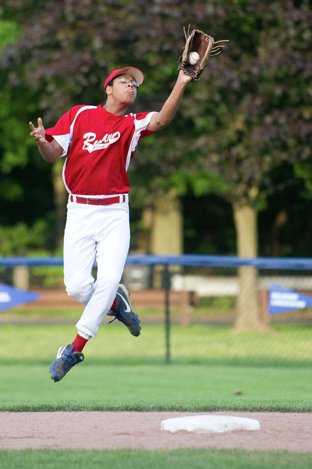 Stamford American's Lewis Baer makes a catch for an out during Saturday's Stamford Little League Tounament of Champions final game at Springdale Little League Field on June 22, 2013. Photo: Lindsay Perry / Stamford Advocate