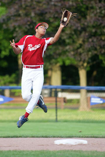 Stamford American's Lewis Baer makes a catch for an out during Saturday's Stamford Little League Tou