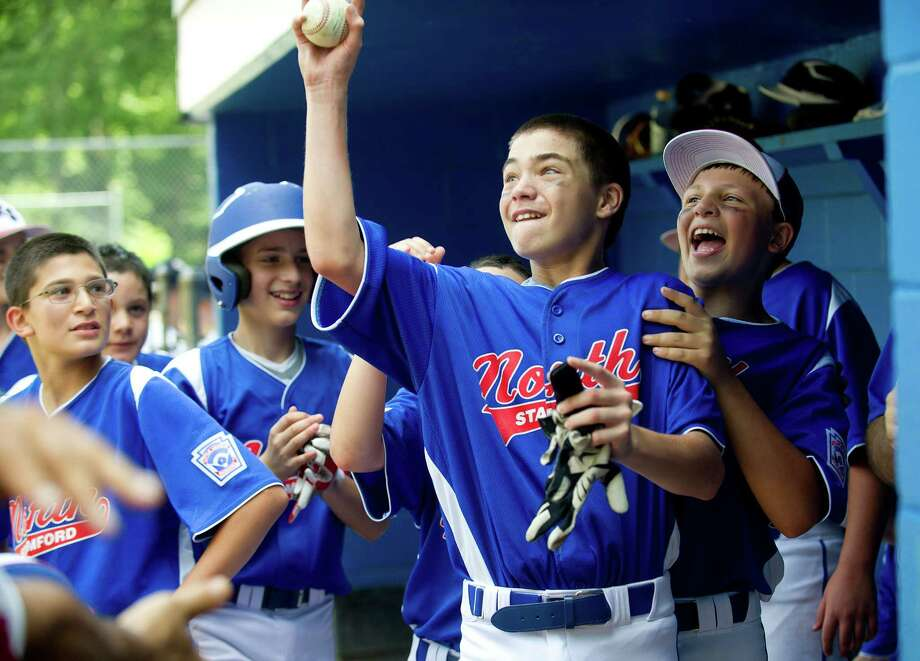 North Stamford's Jack Miezels is congratulated as he gets his home run ball after hitting a grand slam during Saturday's Little League quarterfinal game at Chestnut Hill Park in Stamford, Conn., on July 6, 2013. Photo: Lindsay Perry / Stamford Advocate