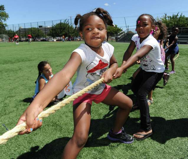 Amiya Johnson, 6, competes in the tug-of-war during Community Fitness Day at the Boys and Girls Club