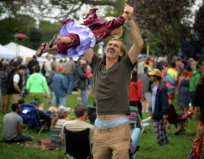 John O'Mara, of Bethel, swings his daughter Redding, 2, into the air at the 18th annual Gathering of