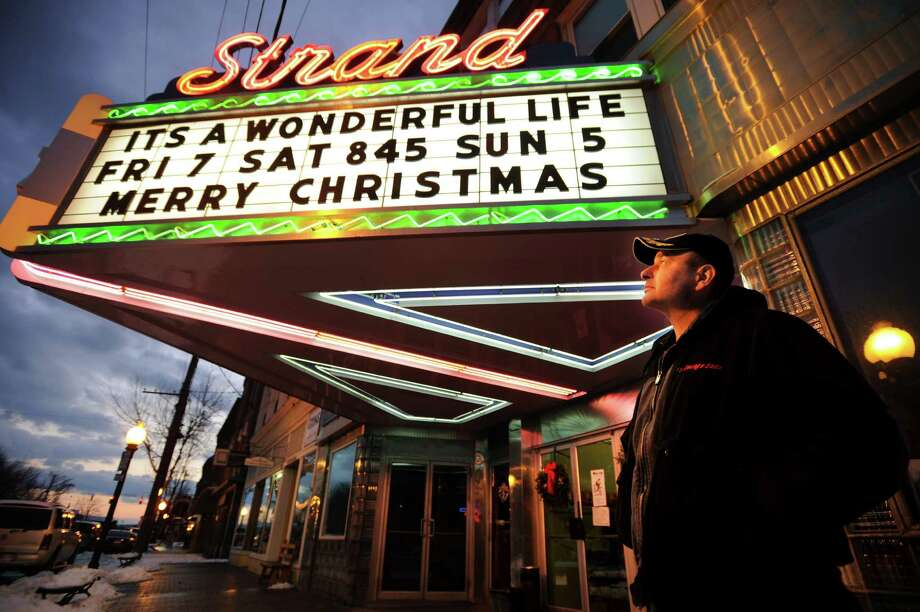 "Seymour native Greg Barna looks at the marquee of the Strand Theater at 165 Main Street in downtown Seymour, Conn. on Sunday, December 15, 2013. The theater, which is closing, showed its final film, Frank Capra's ""It's a Wonderful Life"", on Sunday. Calling the closing ""a shame"", Barna said he has been going to the theater since he was five years old. Photo: Brian A. Pounds / Connecticut Post"