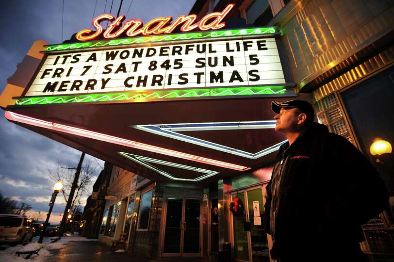 Seymour native Greg Barna looks at the marquee of the Strand Theater at 165 Main Street in downtown