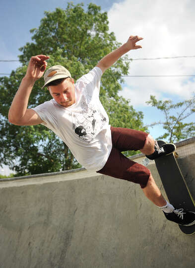 Matt Pockett of Bridgeport drops into the pool at the town skate park at Jennings Beach in Fairfield
