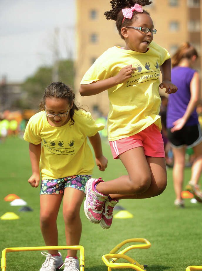 Carver Center Camp campers Nicole Salazar, 7, left, and  Laneese Williams, 8, both of Norwalk, take part in the Third Annual Chelsea Cohen Fitness Academy Jamboree at the University of Bridgeport on Thursday, August 8, 2013. Photo: Brian A. Pounds / Connecticut Post