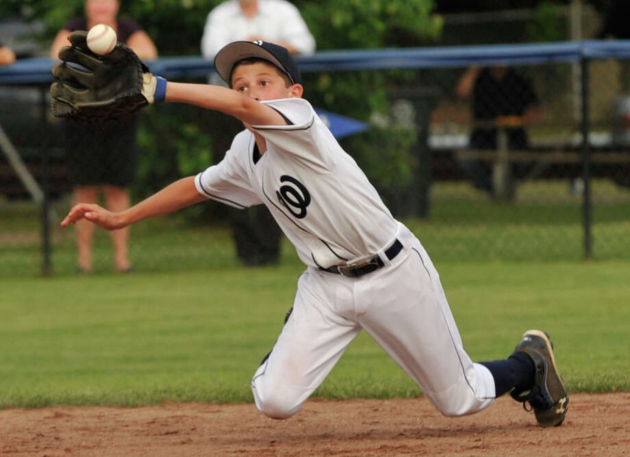 Wilton second baseman Matt Cipri catches a pop-up during their game against Springdale at Michael J. Drotar Park in Stamford on Tuesday, June 25, 2013. Wilton won, 10-1, in 5-innings. Photo: Jason Rearick / Stamford Advocate