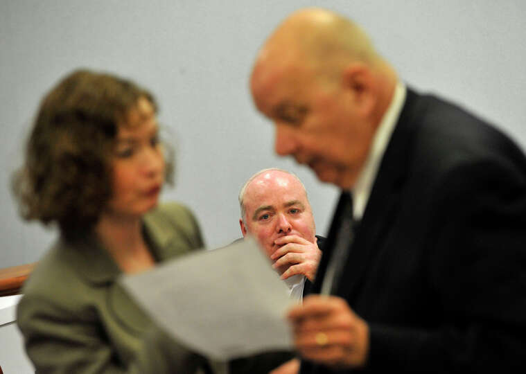 Michael Skakel, center, looks on as his defense attorneys Jessica Santos, left, and Hubert Santos ta