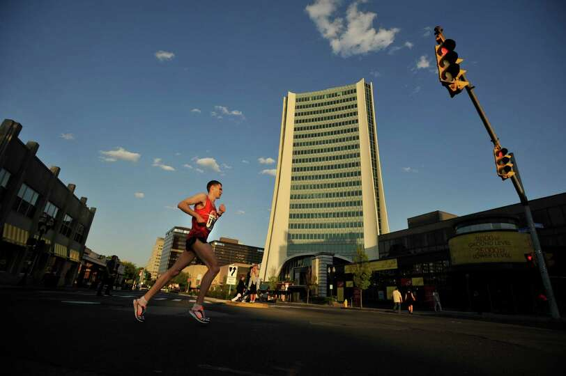 The lead runner crosses Broad onto Atlantic Street during the RFR 5k run/walk in downtown Stamford o
