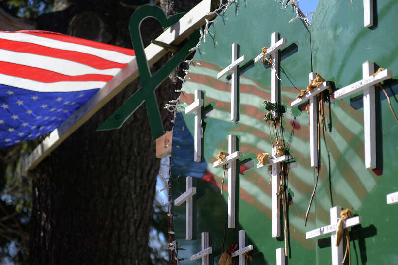 A memorial at a house near Sandy Hook Elementary School in Sandy Hook, Conn. on Thursday, Feb. 21, 2