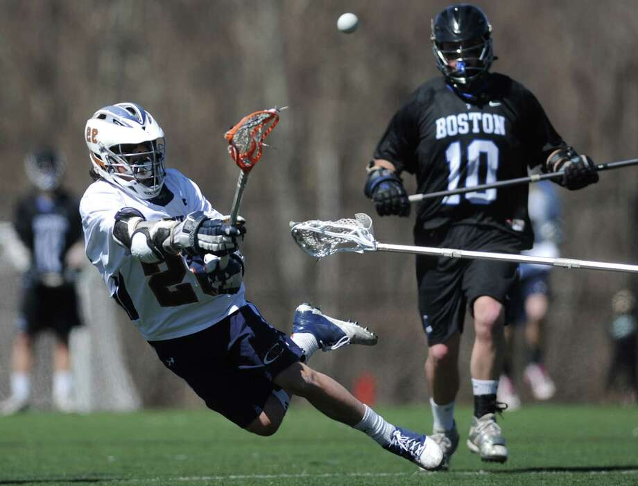 Western Connecticut State's Anthony Nejame (28) shoots and scores a goal during Western Connecticut State University's 20-11 win over University of Massachusetts Boston in men's lacrosse at Western Connecticut on Saturday, April 6, 2013.  Nejame had three goals in the contest. Photo: Tyler Sizemore / The News-Times