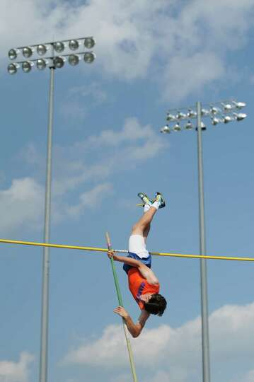 Danbury's Leland Roberts competes in the boys pole vault at the FCIAC Track and Field Championships