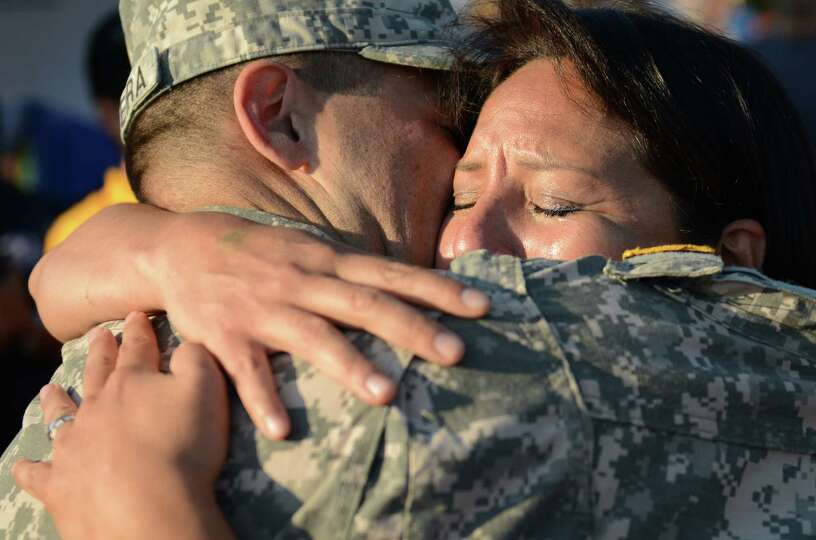 U.S. Army soldier Brian Ferreira is reunited with his wife, Victoria, during the Summer Kick Off at