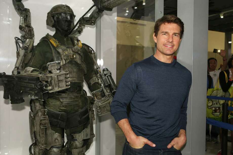 """Edge of Tomorrow"" Tom Cruise does ""Groundhog Day"" as a soldier in a future space war who relives the same battle over and over again. Does Tom Cruise only do futuristic movies these days so that we'll forget his past? Because we never will, Tom. Photo: Chris Frawley, WBTV Via Getty Images / 2013 WBTV"