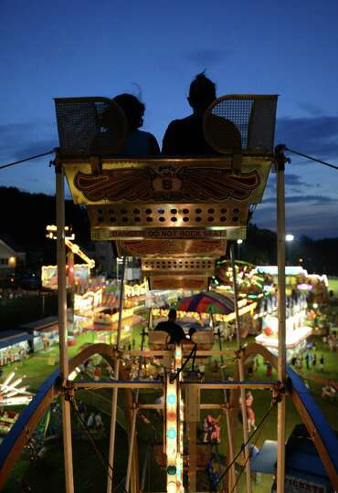 Carnival-goers get a nice view while riding the Ferris wheel at the New Fairfield Lions Club Olde Ty