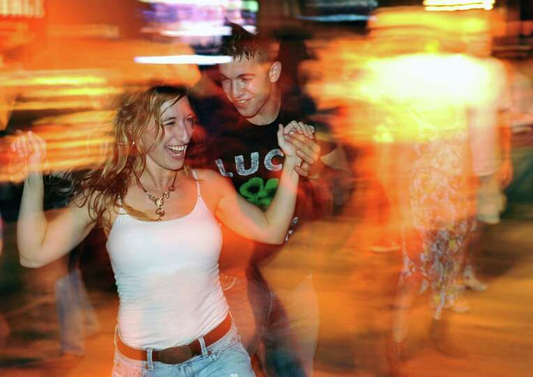 Tara Schimer and Jeff Peterson, of New Milford, dance during line dancing night at Coyote Maverick C