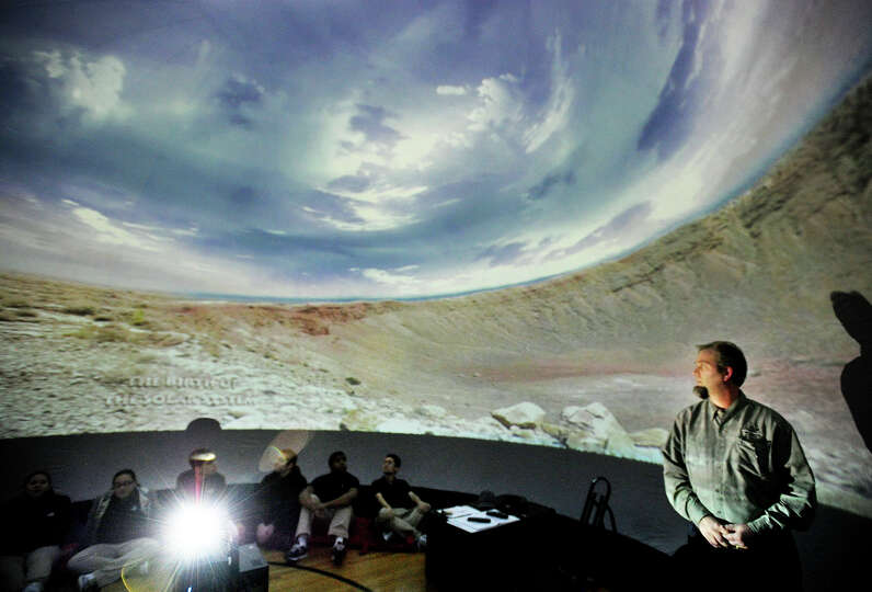 Brian O'Shea teaches his astronomy class inside a new portable planetarium at Bassick High School in