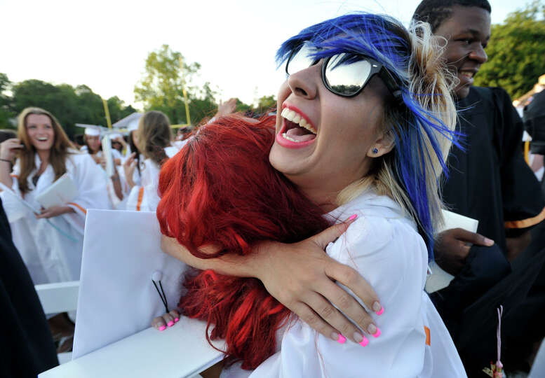 Shanda Silva, right, hugs Kathy Barrera at the end of the Stamford High School graduation ceremony o