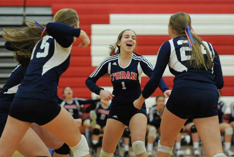 Foran's Kaylee Ciolino (1) celebrates after a point in the class M girls volleyball semifinal game b
