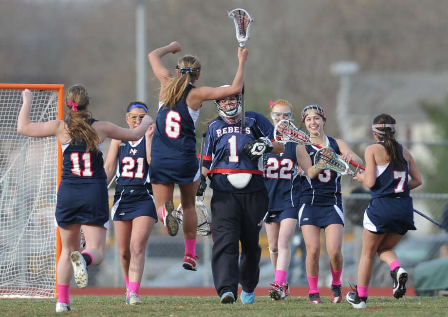 New Fairfield's Casey Jageman (6) jumps in celebration after her team's season-opening 13-11 win over New Milford in girls lacrosse at New Milford High School on Thursday, April 4, 2013.  This was the first game for New Milford's new coach, John Murphy, who will also be the new high school football coach next season. Photo: Tyler Sizemore / The News-Times