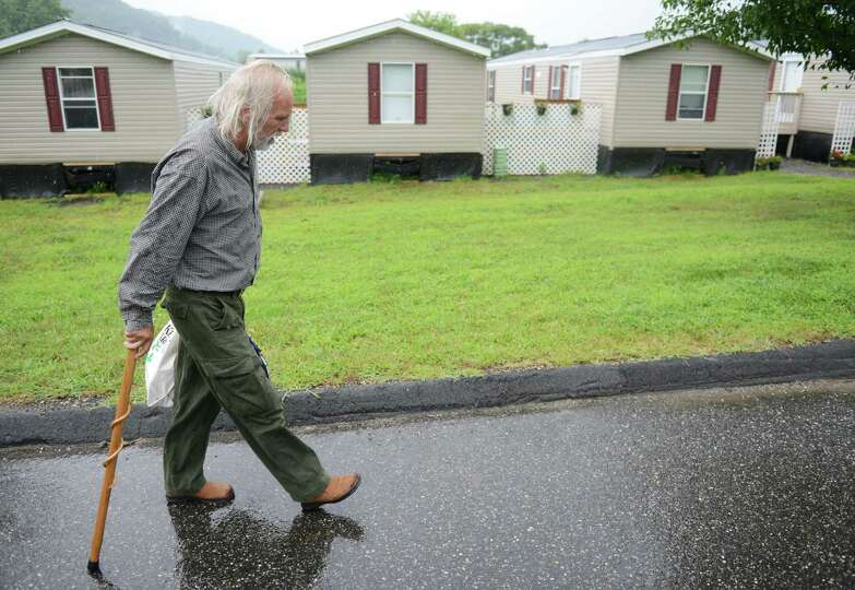 Former Staten Island resident Dennis Klaus walks outside of the Faith Church mobile home camp for Hu
