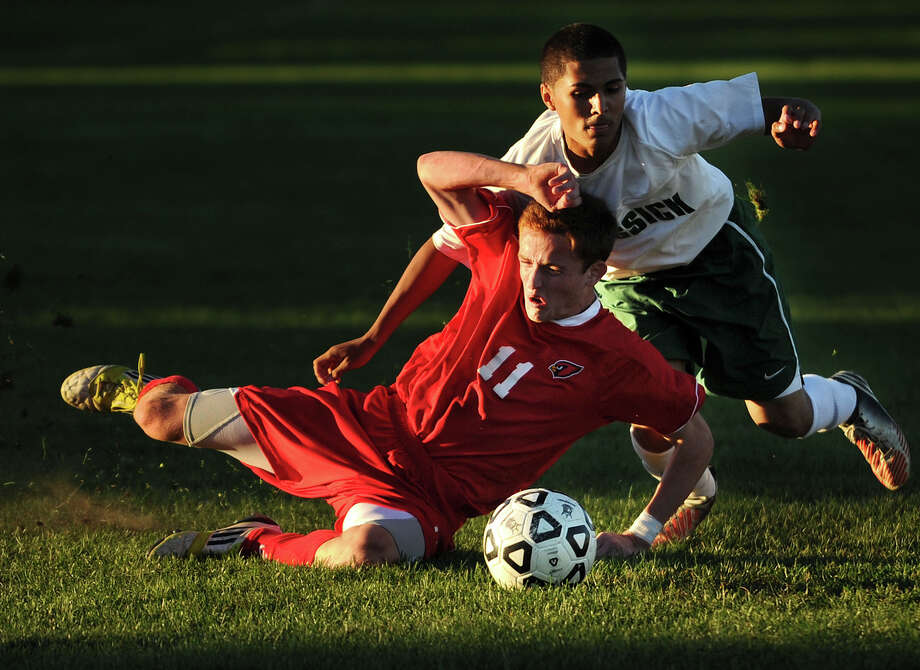 Greenwich's Patrick Santini is defended by Bassick's Ivan Gonzalez in the second half of their FCIAC boys soccer matchup at Went Field in Bridgeport, Conn. on Monday, September 23, 2013. Photo: Brian A. Pounds / Connecticut Post