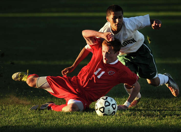 Greenwich's Patrick Santini is defended by Bassick's Ivan Gonzalez in the second half of their FCIAC
