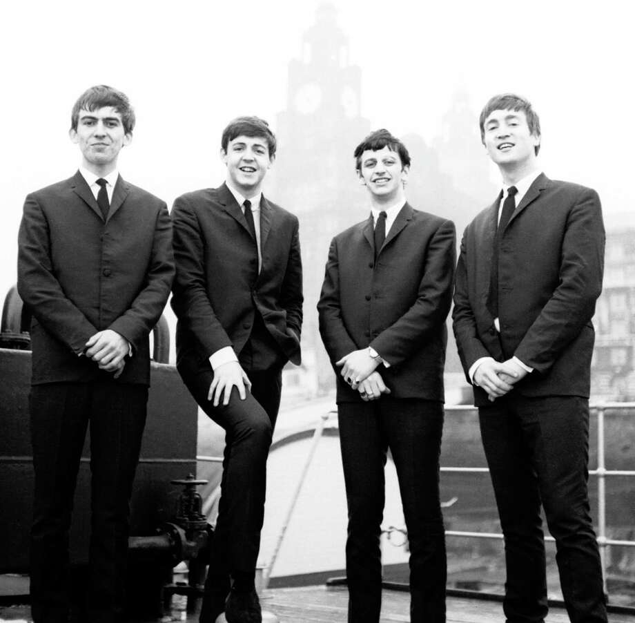 The Beatles were a new band when this photo was taken in 1962. Before Ringo Starr, third from left, joined the band, he considered emigrating to Houston. Photo: Handout / handout