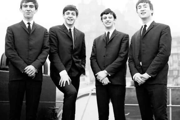 The Beatles were a new band when this photo was taken in 1962. Before Ringo Starr, third from left, joined the band, he considered emigrating to Houston.