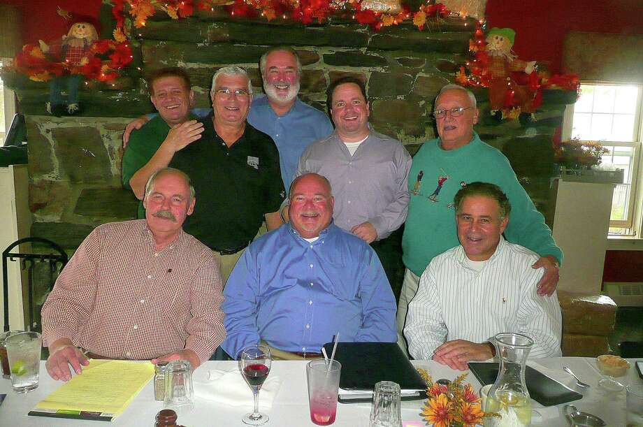 "Members of the Umbrella Club of Lower Fairfield County, a club that whose mission is ""to help people,"" include, seated from left: Stamford residents Hank Anderson, secretary;  Bruce Moore, outgoing president; and Mike Mezzapelle, treasurer. In the back row, from left, are: Stamford resident Mike Zody, founder and Greenwich resident Jim Pucci, Tom Heide of Wilton, Scott Kelly of Norwalk, and Greenwich resident and founder Peter Orrico. Photo: Picasa, Anne W. Semmes / Greenwich Citizen"