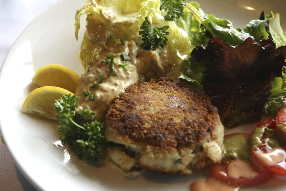 Frederick's Bistro's Spicy Rémoulade Sauce with crab cakes. There, Asian and French blend very well. Photo: Express-News File Photo / SAN ANTONIO EXPRESS-NEWS