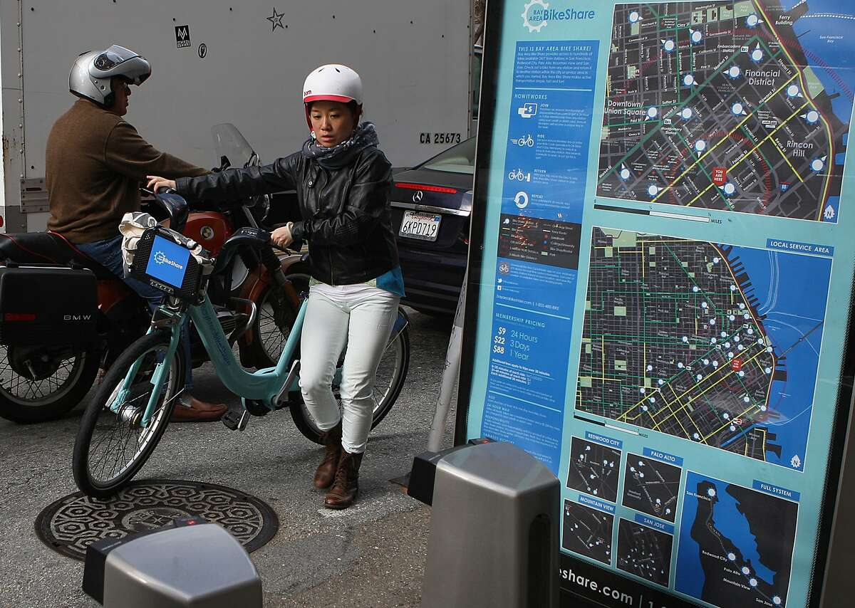 A commuter arrives at the Bay Area Bike Share station on 2nd @ Folsom streets in San Francisco, California, to get to work on Tuesday, November 12, 2013.