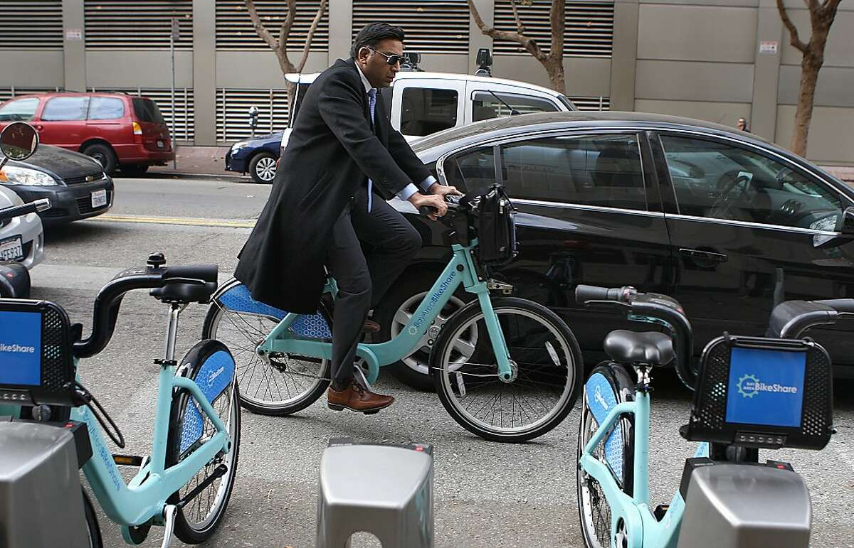 Sudhish Verma arrives at the Bay Area Bike Share station on 2nd @ Folsom streets in San Francisco, California, to get to work on Tuesday, November 12, 2013.