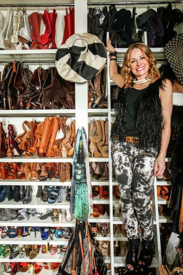 Lucinda Loya estimates she owns about 300 pairs of boots. Photo: Eric Kayne, For The Chronicle / Eric Kayne