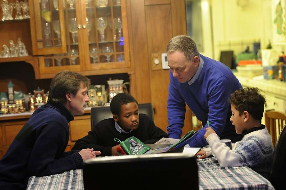Brian (left) and Kevin Fisher-Paulson (right) and adopted sons Zane and Aidan gather at the kitchen table in their S.F. home. Photo: Susana Bates, Special To The Chronicle