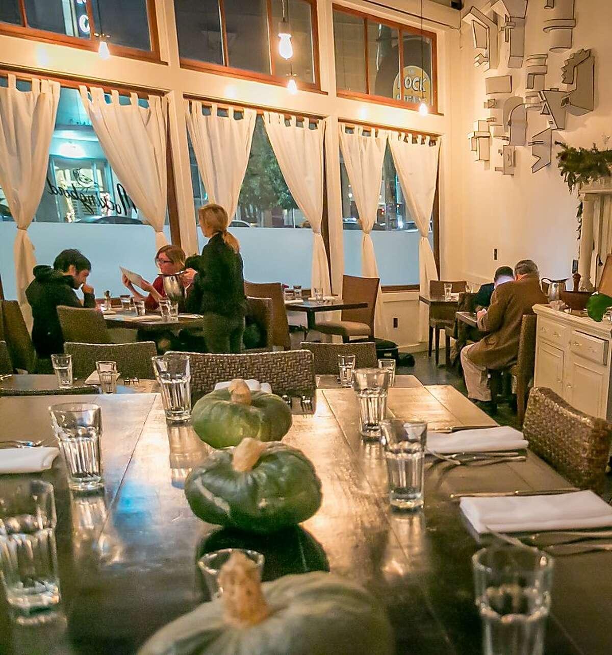 diners enjoy dinner at Mockingbird restaurant in Oakland, Calif., is seen on December 27th, 2013.