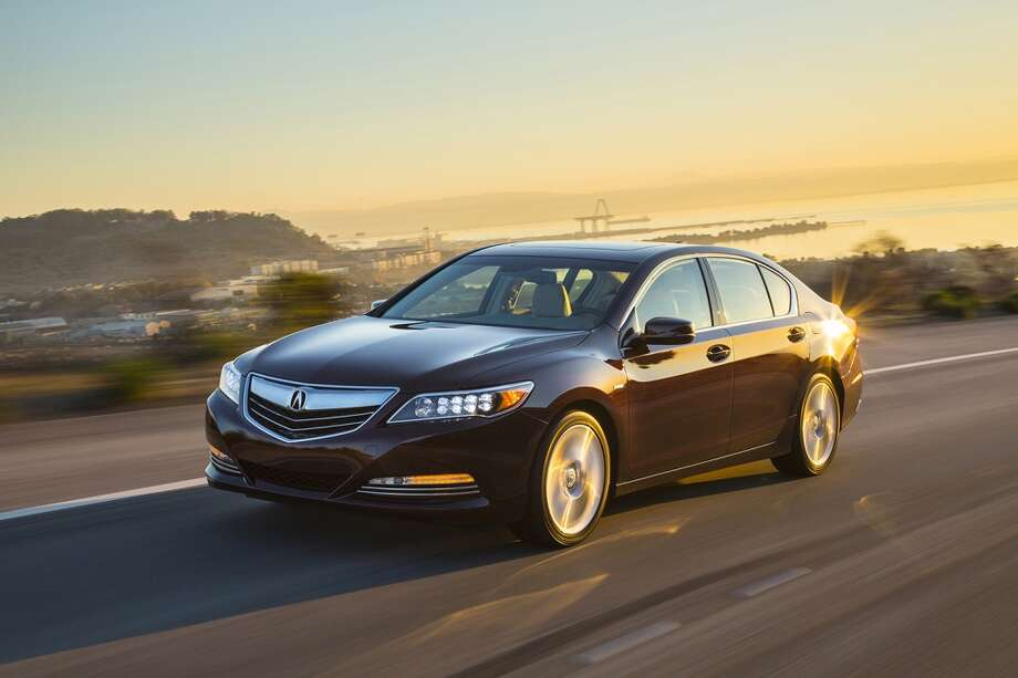 "Acura RLX SH-AWD. A mouthful, that, with the latter standing for ""Super Handling-All Wheel Drive."" It's the first regular production car powered by three electric motors and a gasoline engine. Big luxo sedan that competes in the roughly $60,000 area. Photo: Honda, Wieck"