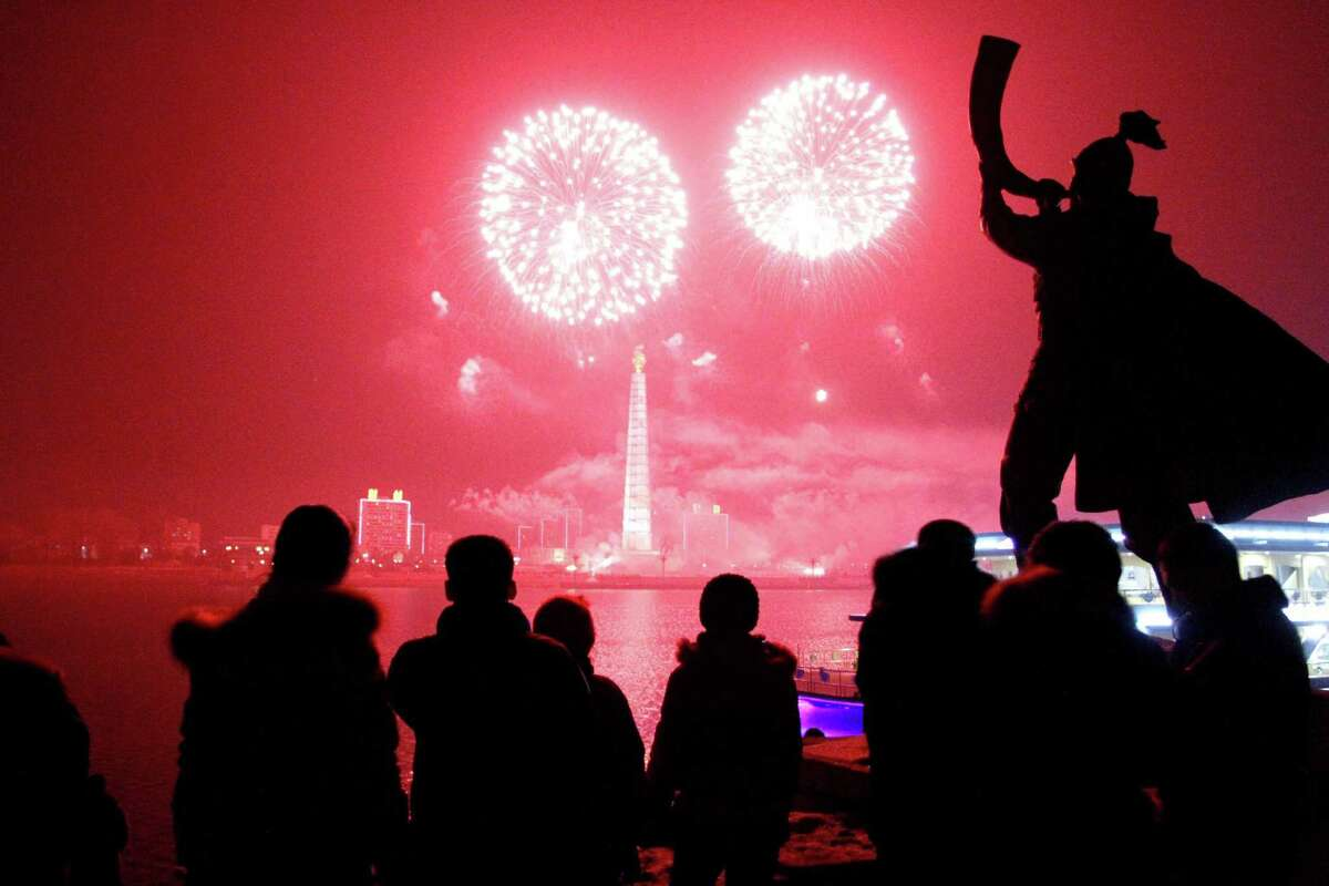 Fireworks explode over Juche Tower and the Taedong River in Pyongyang, North Korea, to celebrate the New Year on Wednesday.