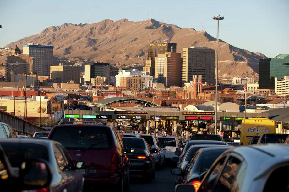 In this photo, taken Dec. 26, vehicles line to cross the Paso del Norte Bridge between El Paso and Ciudad Juarez toward El Paso. Twenty years ago, the North American Free Trade Agreement went into effect, dramatically changing Mexico in fundamental ways but the treaty never met many of its sweeping promises to close Mexico's wage gap with the United States, boost job growth, fight poverty and protect the environment. (AP Photo/Ivan Pierre Aguirre) Photo: Ivan Pierre Aguirre, STR / AP
