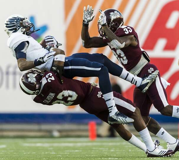 Rice wide receiver Dennis Parks (4) is slammed to the turf by Mississippi State defensive back Tavez