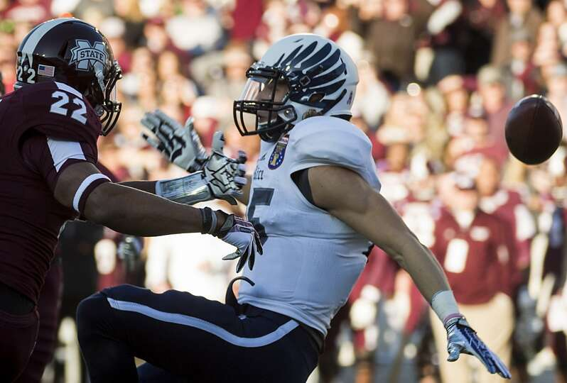 Mississippi State defensive back Taveze Calhoun (23) breaks up a pass intended for Rice wide receive