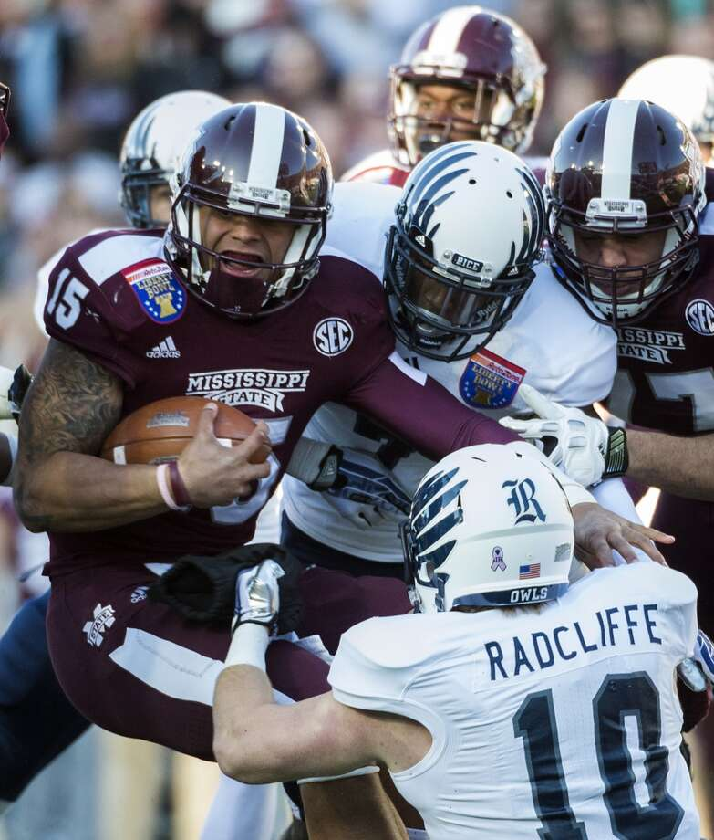 Mississippi State quarterback Dak Prescott (15) is brought down by Rice safety Julius White (7) and linebacker James Radcliffe (10) during the first half. Photo: Smiley N. Pool, Houston Chronicle