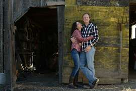 Steve and Jill Klein Matthiasson pose near the entrance to their barn at their home in Napa. December 19, 2013.