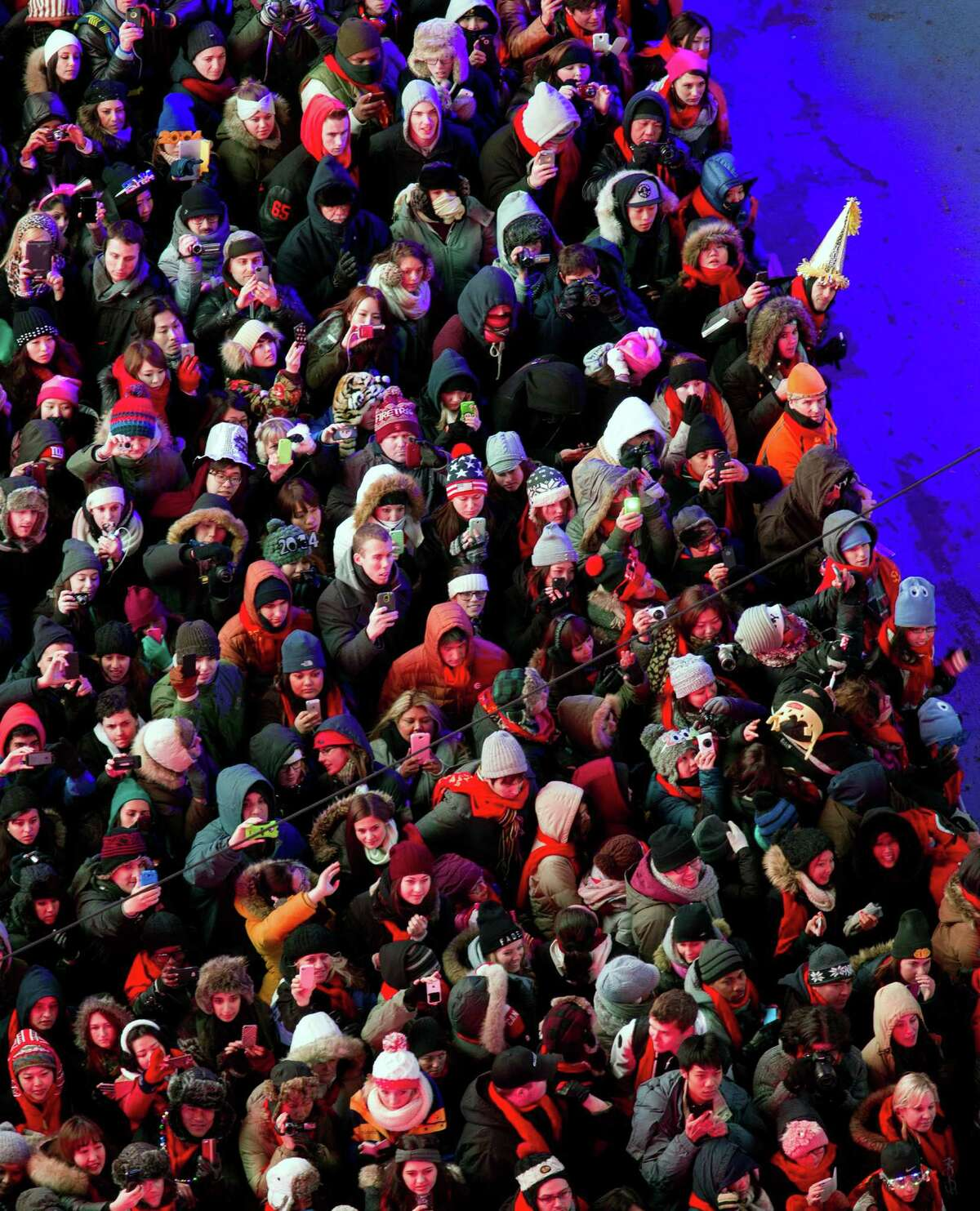 Looking from the Marriott Marquis hotel, people crowd into Times Square for New Year's Eve celebrations in New York Thursday, Dec. 31, 2013.